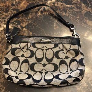 A mini coach purse